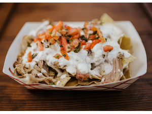 Picture of Pork Nachos- topped with fresh pico and covered in provolone queso, served with a drink